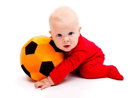 Surprised soccer baby with his mouth  open photo