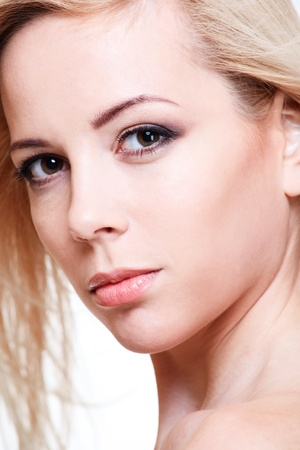Closeup portrait of a beautiful blond girl Stock Photo - 8867054