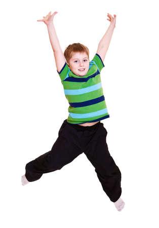 Vrolijke kid springen, over white Stockfoto