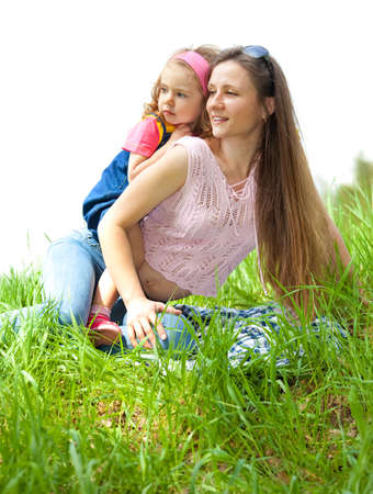 Mother and her curly daughter in grass photo