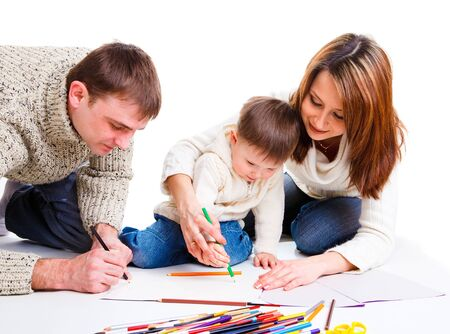 Parents drawing together with  their toddler son photo