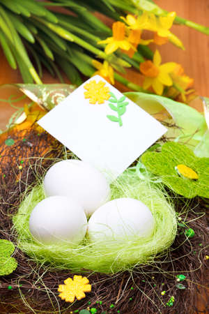 Eggs nest decorated with flowers and beads photo
