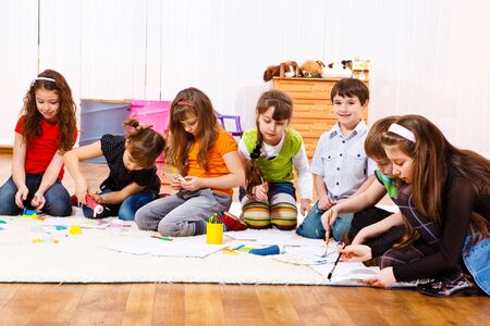 Junior students busy with painting  Stock Photo - 9060804