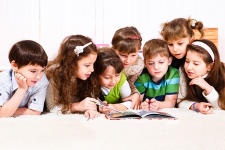 Kids crowd reading a book Stock Photo - 9060837