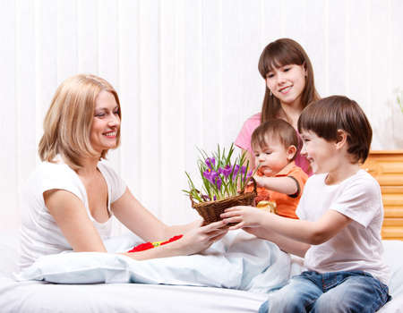Kids greeting mom with Mother's Day Stock Photo - 9060801