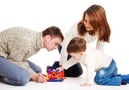 Kid and his parents playing with toy train Stock Photo - 9060836