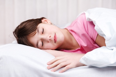 sleeping kid: Portrait of a teenage girl sleeping Stock Photo