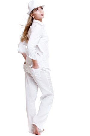 Elegant woman in white clothing looking up Stock Photo - 9191476