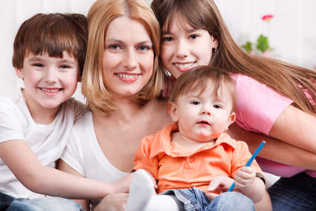 Smiling woman and her three kids photo