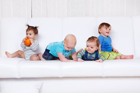 Four friends having leisure time on the sofa photo