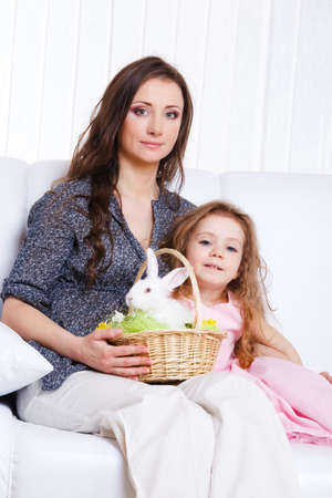 Mother and daughter with the Easter bunny in basket photo