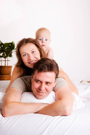Lovely happy family in the bedroom Stock Photo - 9191486