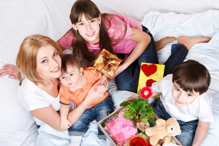 Kids holding presents for their mother Stock Photo - 9191531