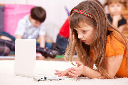 Attractive girl looks attentively at the laptop screen Stock Photo - 9191523