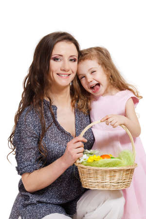 Woman and laughing kid holding Easter basket photo