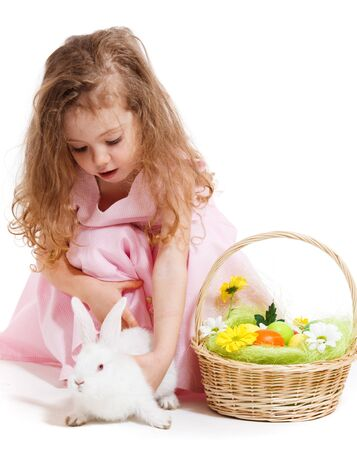 beautiful rabbit: Lovely preschool girl playing with Easter bunny Stock Photo
