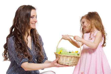 Daughter giving Easter basket to her mom photo