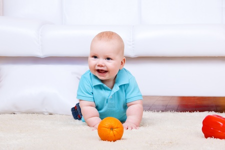 Cheerful kid crawling on the floor photo