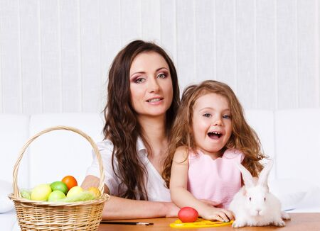 Mother and daughter with the Easter bunny and basket photo