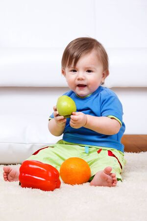 Happy kid eating healthy food photo