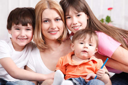 Portrait of mother and happy children photo