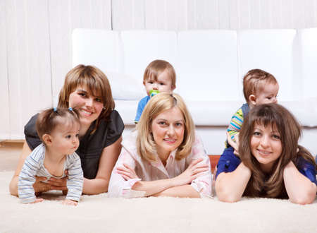 Three mothers with kids, lying photo