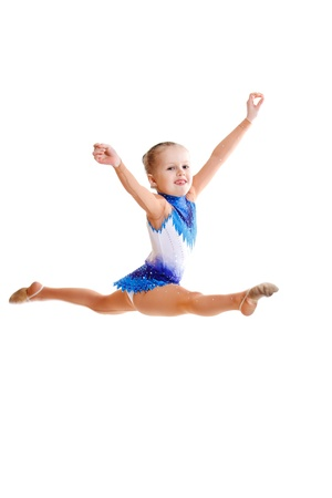 female gymnast: A beautiful young gymnast jumping, isolated