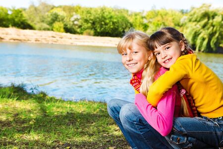 Two cheerful  little girls embracing Stock Photo - 9330609