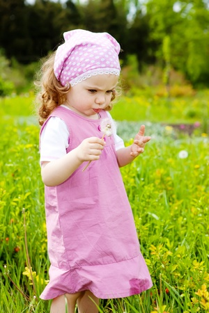 A sweet girl in the garden, with dandelion Stock Photo - 9330595