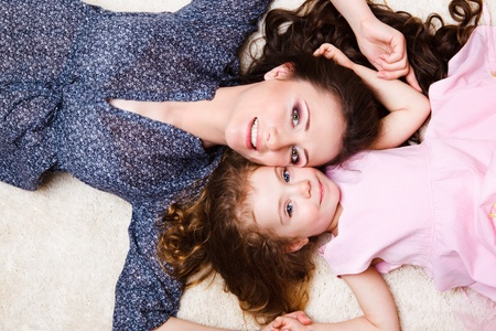 Mother and daughter laying close to each other Stock Photo - 9330611