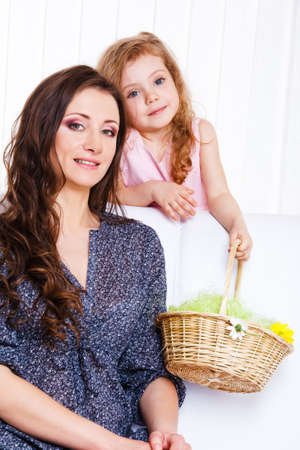 Woman and child holding wicker basket with flowers photo