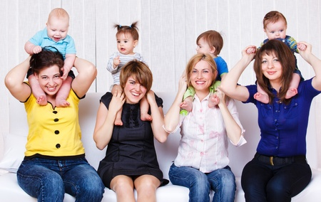 Laughing mothers and their children photo