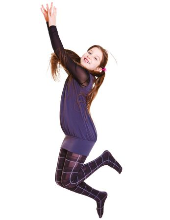 Cheerful girl with long hair jumping and catching something Stock Photo - 9330548