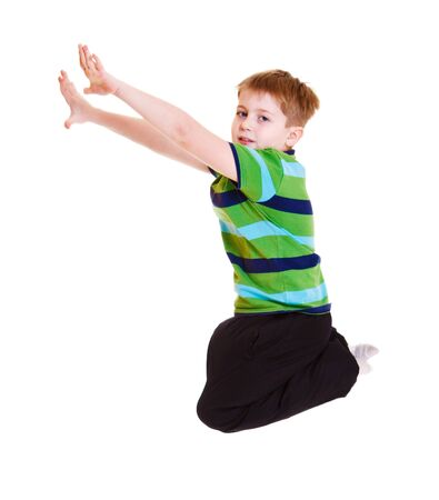Boy in striped t-shirt jumping Stock Photo - 9330541