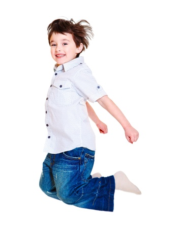 Excited child jumping up high, isolated Stock Photo - 9330549