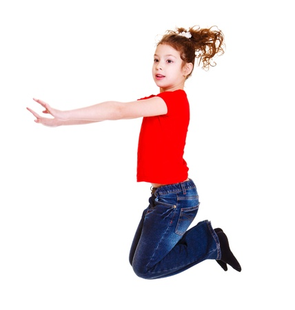 Junior female student in red t-shirt jumping Stock Photo - 9330543