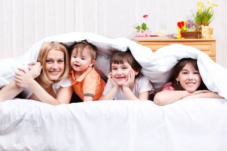 Mother and three kids laughing photo
