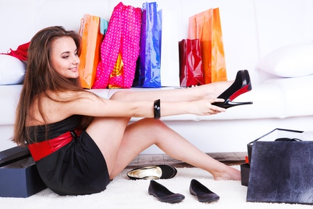 Beautiful teenage girl trying on new shoes photo