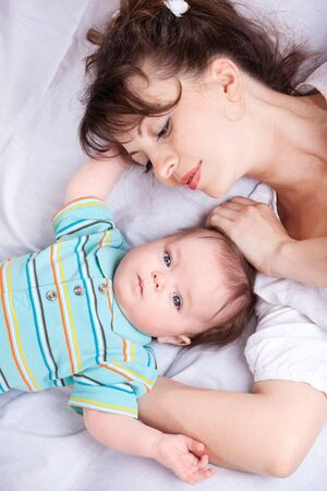 Loving mother looking at baby boy Stock Photo - 9444090