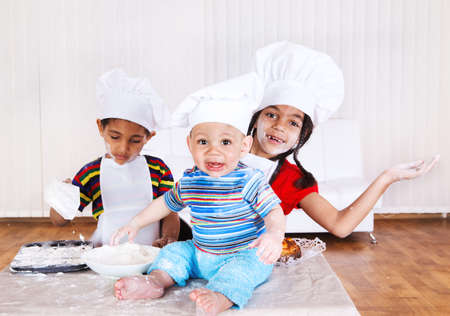 Cheerful children in aprons and hats  photo