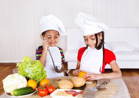 black sesame: African american kids cooking Stock Photo