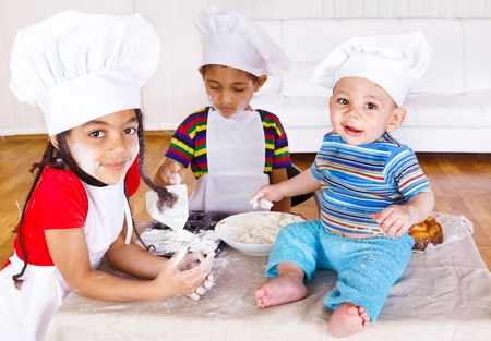 Three african american kids playing with flour Stock Photo - 9444078
