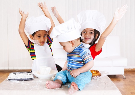 naughty girl: African american kids in cook costumes raising hands  Stock Photo