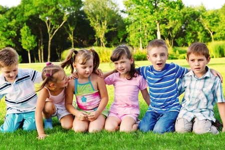 Six happy preschool friends embracing photo