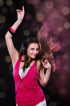 Dancing teen in the headphones photo