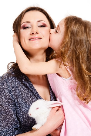Happy child kissing mother  photo
