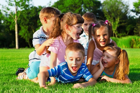 Preschool friends playing and laughing in the backyard