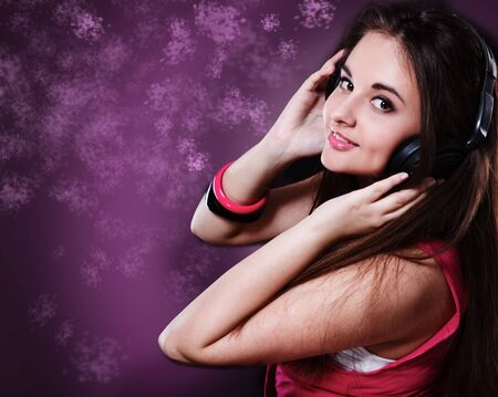 Portrait of a young girl with headphones on photo
