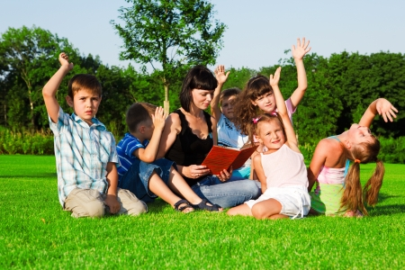 kids learning: Kids group having  lesson n the outdoor Stock Photo