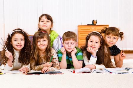 child book: Lovely friends team reading books Stock Photo